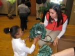 Corps member, Jasmin Lopez, hands out cinch bags