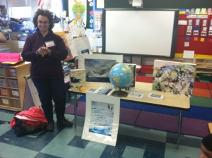 Painter Lisa Goren shows off her work about Antarctica and gives students a background on her paintings.