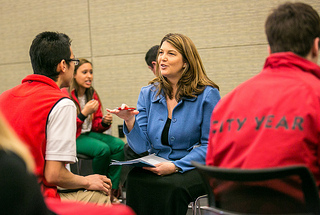 Tracy Baumgartner, Executive Director of Community Investment at Comcast, leading a mock interview. (Photo by Elliot Haney, 2013).