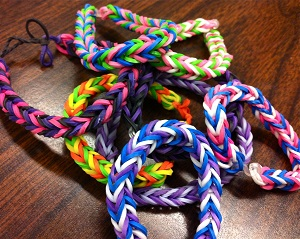Pencil and paper aren't the only ways to create art. A growing artistic fad at my school is bracelet making, specifically bracelets made with small colorful rubber-bands. These handcrafted bracelets are designed and created per request by several of my students, and for many are great ways to show individuality, support of a sports team, or pride by wearing their native country's colors.