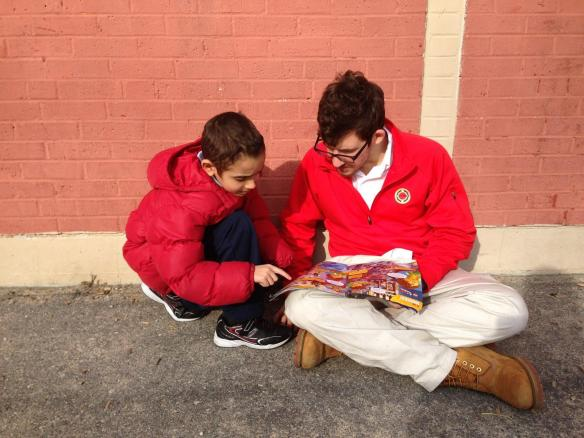 CM and student reading outside