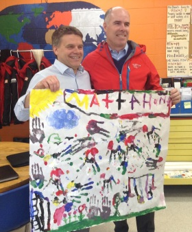 Ed Milano and Bob Klein show off the finger painting they made with Mattahunt students.